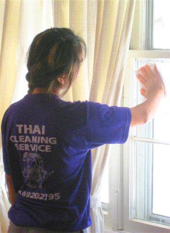 Woman washing a window