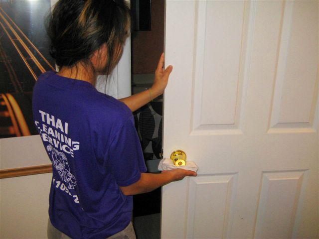 Woman cleaning door knob
